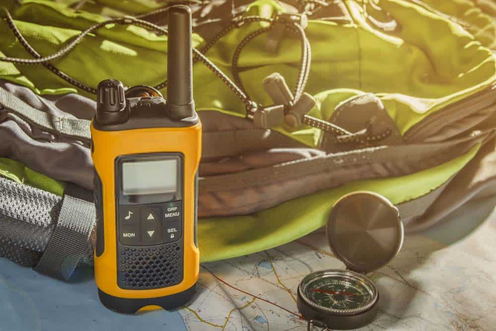 Two way radio next to compass