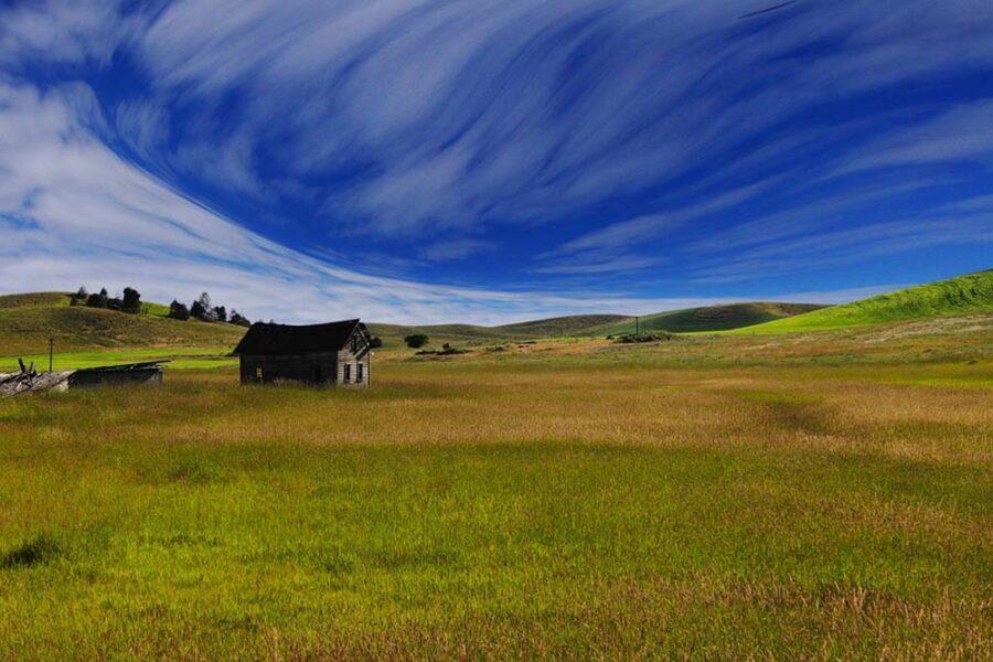 Wooden house in open fields