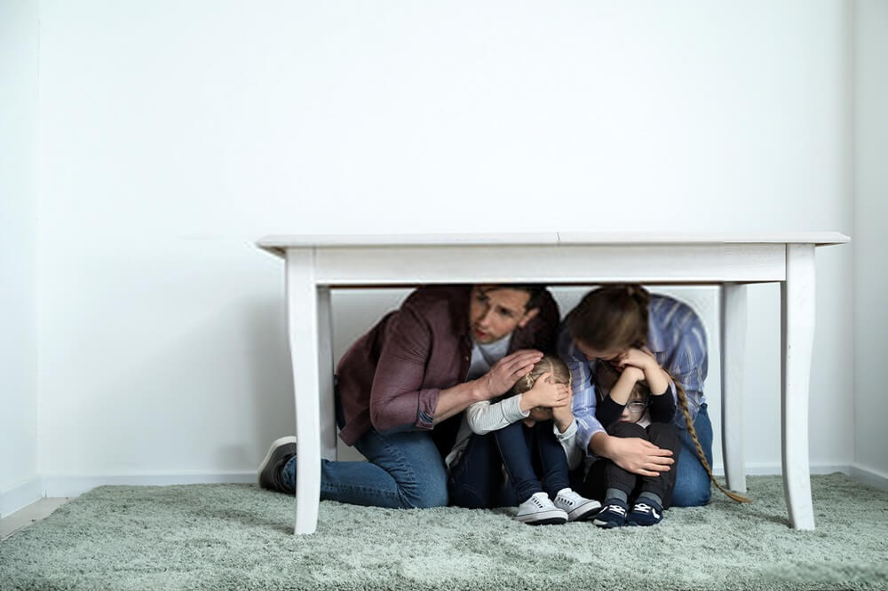 people hiding under a table